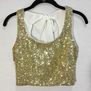 B. Darlin gold sequin halter crop top with bow